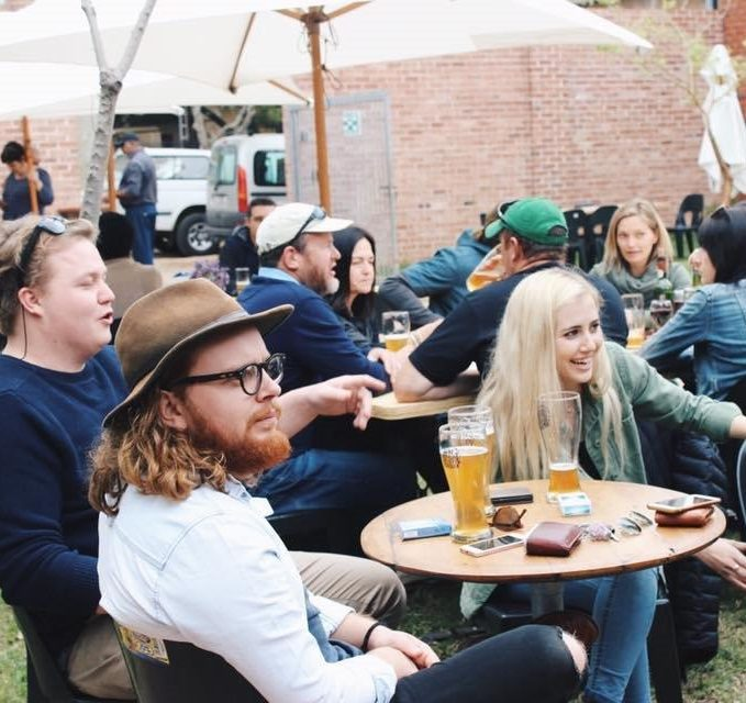 People enjoying craft beer at the Courtyard Events Venue the courtyard berg river brewery for live music, large gatherings and even open-air dance events. The courtyard includes a protected undercover area.